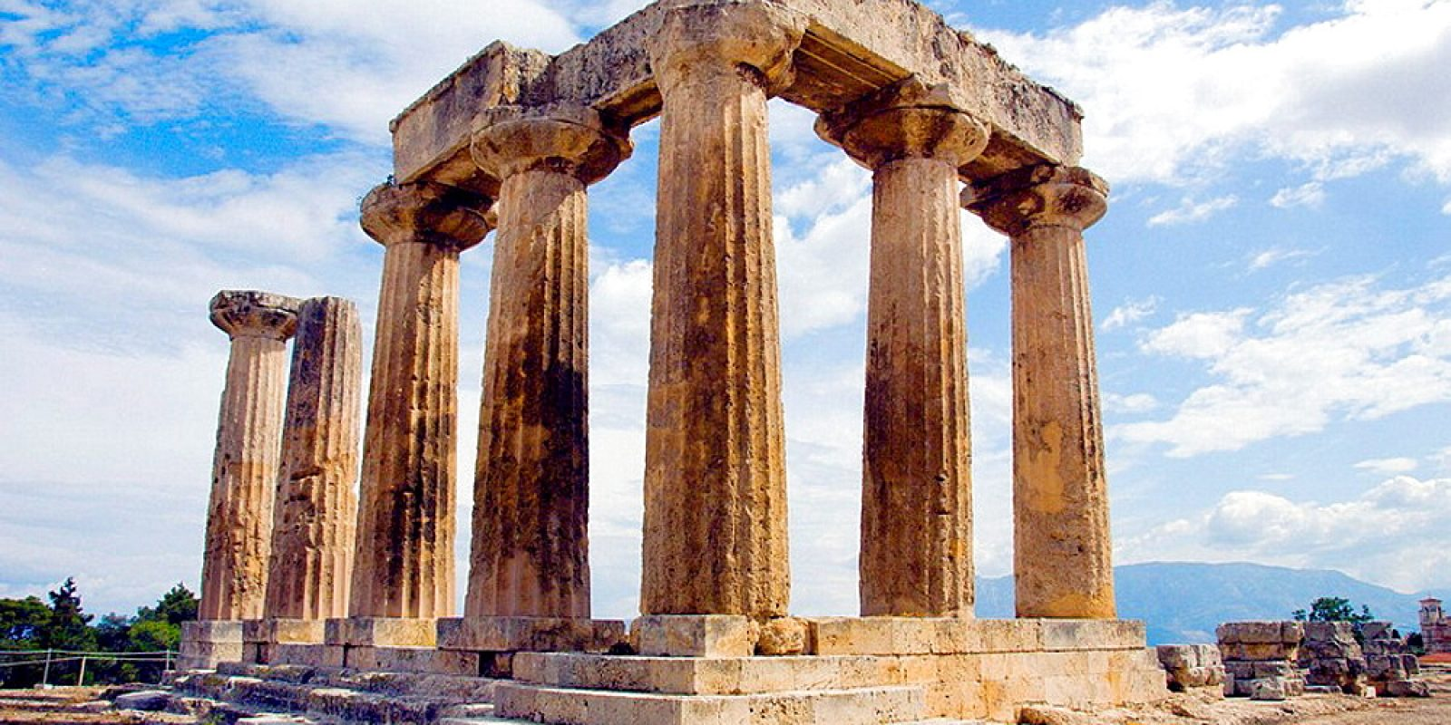 The ruins of the Temple of Apollo in the ancient city of Corinth, Greece